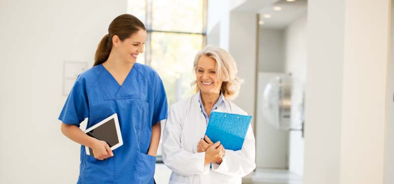 Two Nurses Walking and Smiling in the Practice Environment
