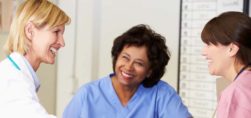 Nurses Talking and Smiling In a Hospital Setting