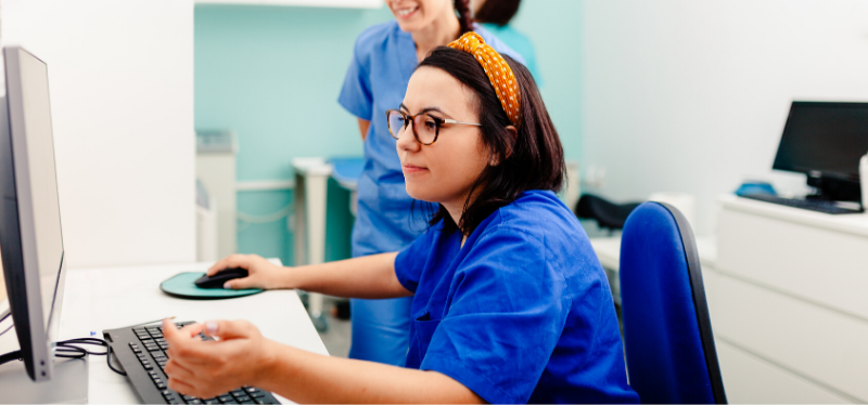 Nurse in Headband Looking at a Computer Screen